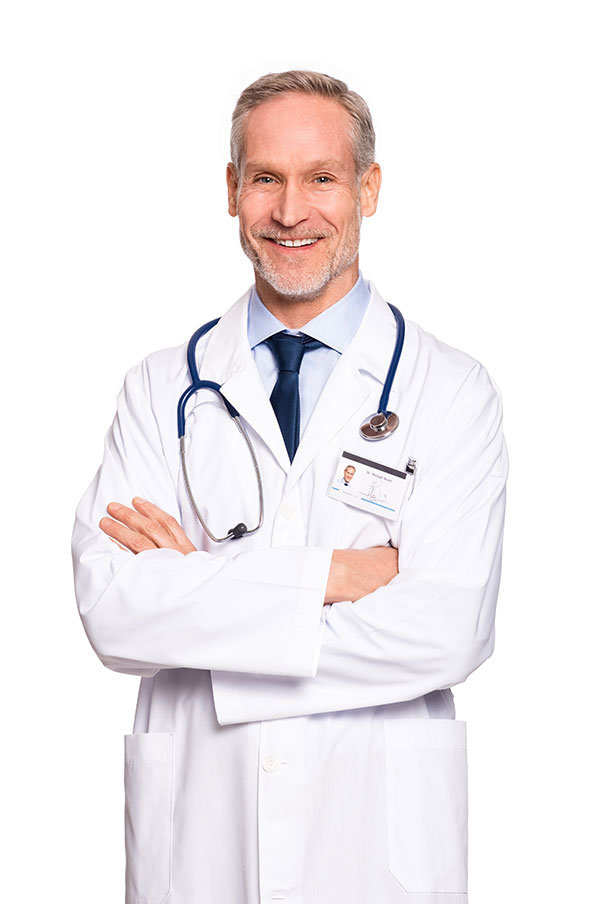 middle aged doctor in lab coat smiling